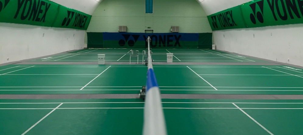 Four badminton courts in permanent hall